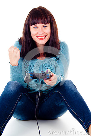A girl playing video games, rejoicing the victory