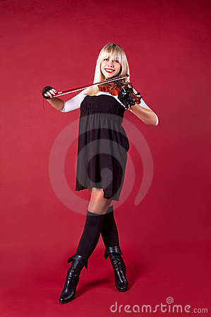 Girl playing violin in studio smile