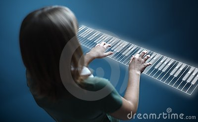 Girl playing on virtual piano keyboard