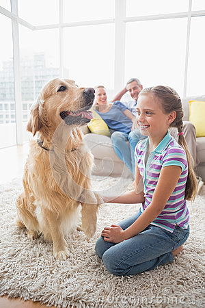Free Girl Playing With Dog While Parents Relaxing At Home Stock Photos - 50492383
