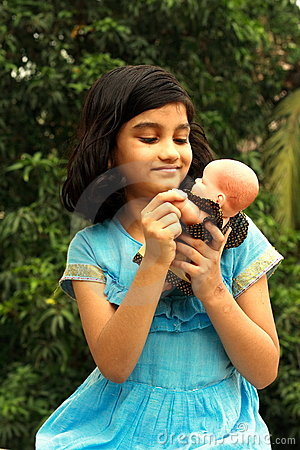Free Girl Playing With Her Doll Stock Image - 9499891