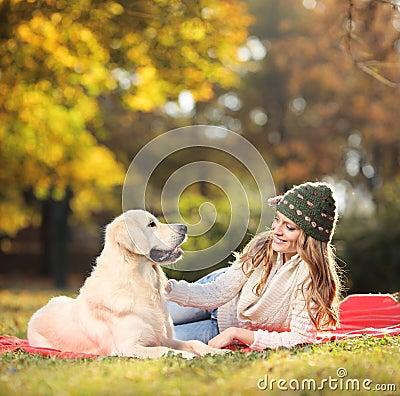 Free Girl Playing With Her Labrador Retriever Dog Stock Photo - 22104980