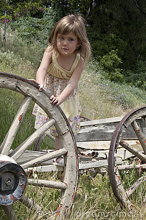 Free Girl Playing With Old Wagon Royalty Free Stock Images - 14075709