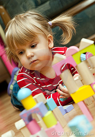 Girl playing with wood blocks