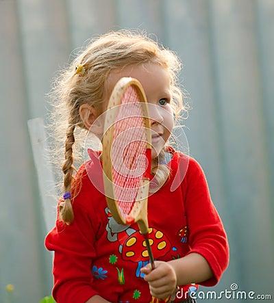 Girl plays in badminton