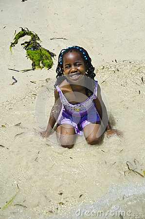 Girl plays at a beach