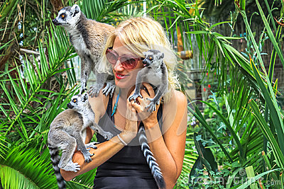 Girl plays with lemurs