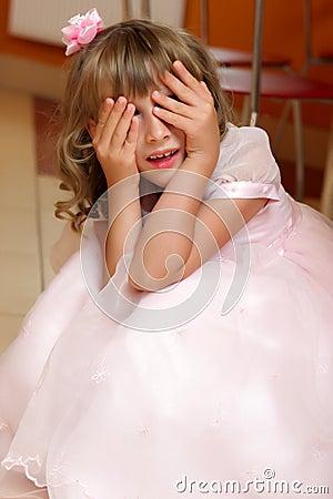 Girl plays hide-and-seek