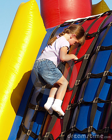 Free Girl Plays Inflatable Bouncy Royalty Free Stock Image - 2496146