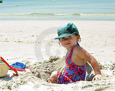 Girl plays on the sand