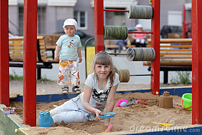 Girl plays in sandbox