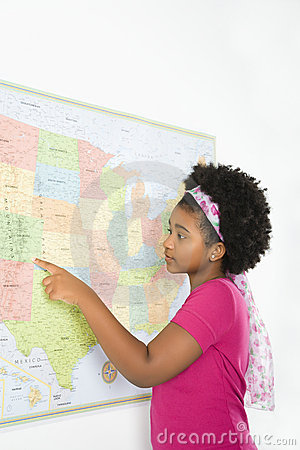 Girl pointing on map.
