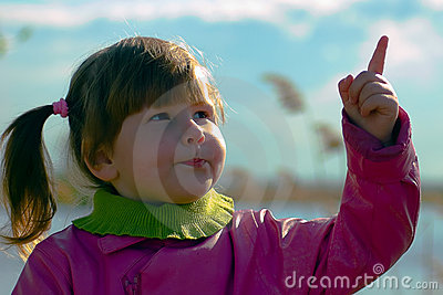 Girl pointing in the sky