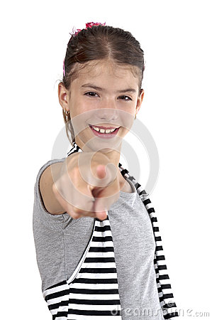 Girl pointing on studio shot