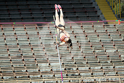 Girl on the pole vault competition Editorial Stock Image
