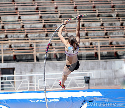 Girl on the pole vault competition Editorial Image
