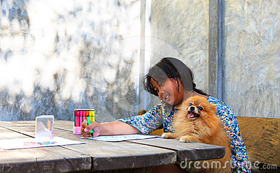 Girl and pomeranian dogs in home garden