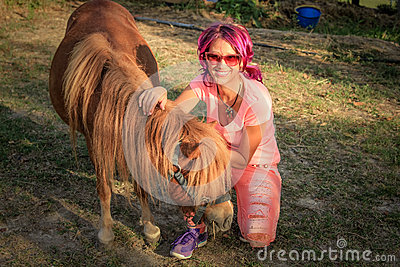 Woman with a Shetland pony
