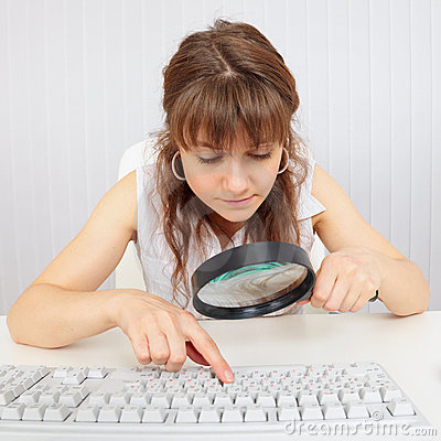 Girl with poor eyesight and computer keyboard