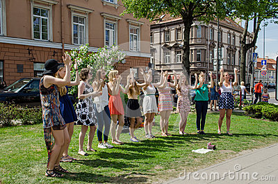 Girl pop group performing dance elements in park