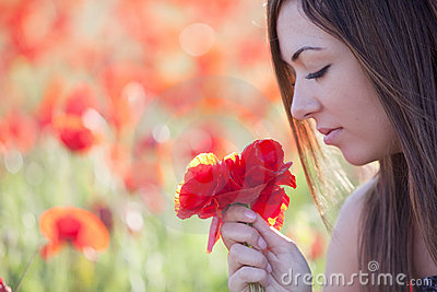 Girl with poppies bunch
