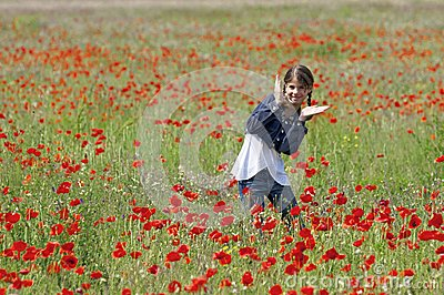Girl with poppies dancing