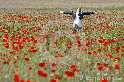 Girl with poppies enjoy
