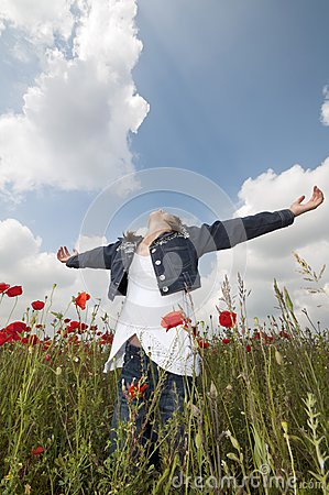 Girl with poppies enjoy wide