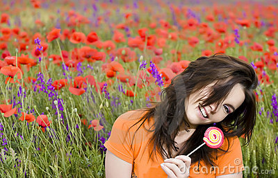 Girl on a poppies field