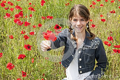 Girl with poppies giving flower