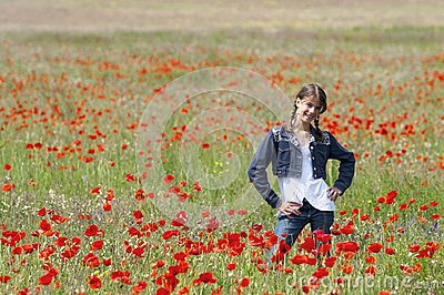 Girl with poppies posing happily