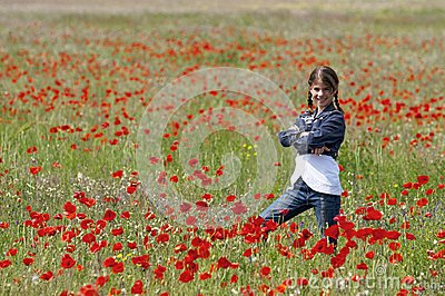 Girl with poppies posing side view
