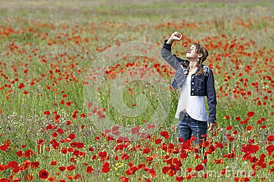 Girl with poppies smelling