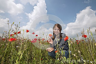 Girl with poppies squatting wide