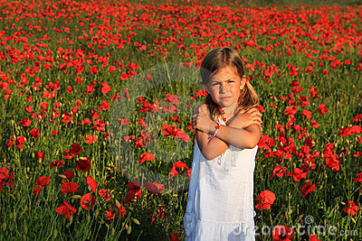 Girl in poppy field