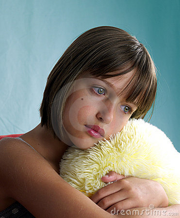 Girl portrait with yellow pillow