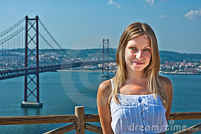 Girl posing against the bridge in Lisbon