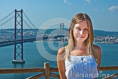 Girl posing against the bridge in Lisbon