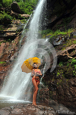 Girl posing in front of waterfalls
