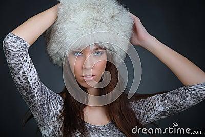 Girl posing in a fur hat