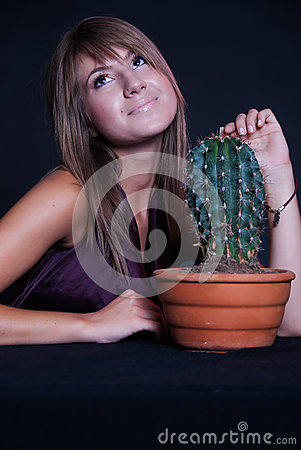 Free Girl Posing In Studio With Cactus Royalty Free Stock Images - 59265749