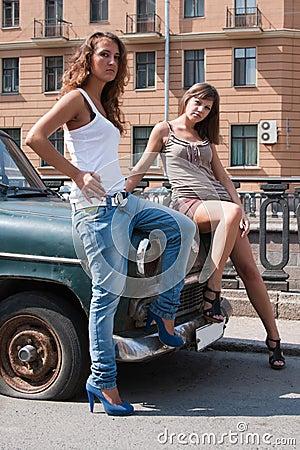 Girl posing next to a retro car