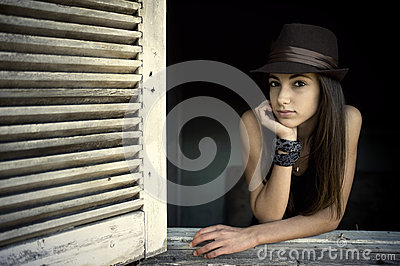 Girl posing in an open window