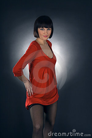 Girl posing in studio on dark background