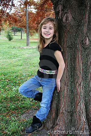 Girl Posing by Tree