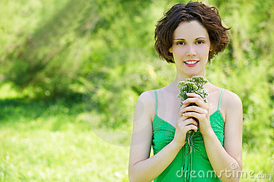 Girl with posy outdoors