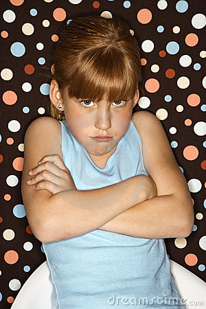 Girl pouting with arms crossed.
