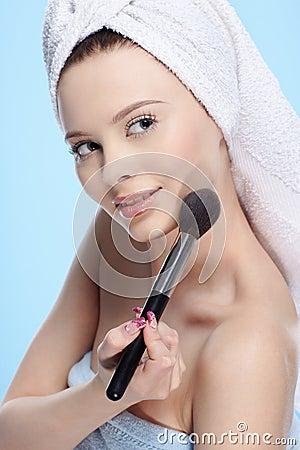 Girl with powder brush