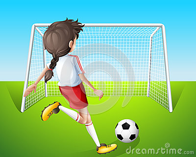 A girl practicing soccer