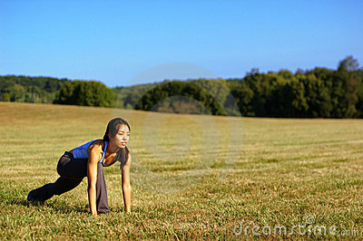Girl Practicing Yoga In Field